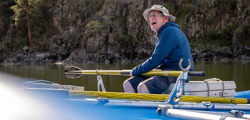 Rafter holding oar situated in open oar lock.